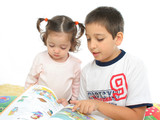 brother and sister reading a book on the floor poster