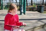 girl reading outside poster