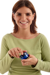 stock photo of a young woman holding cream