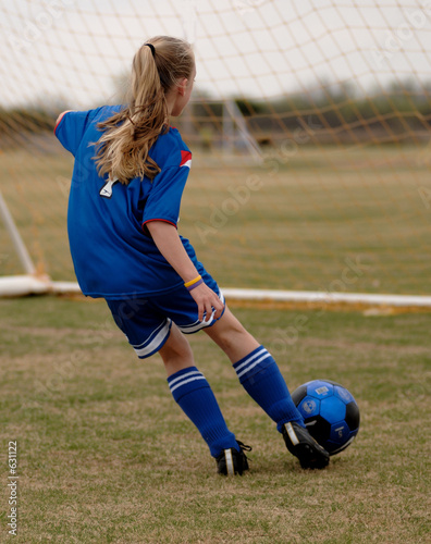 girl playing soccer - football