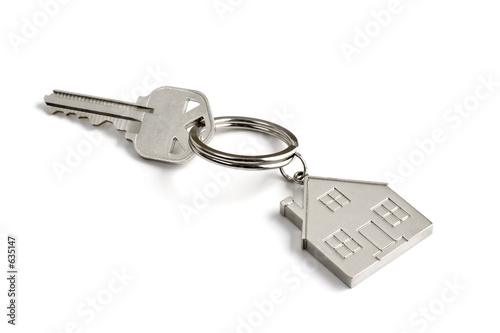 Leinwanddruck Bild metal key with house key ring