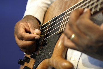 man playing guitar fingering