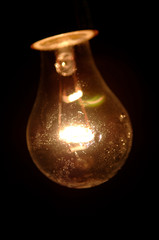 light bulb on black with water