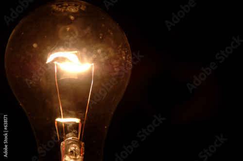 clear light bulb on black