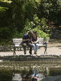 young couple on park bench poster