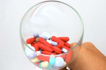 assorted pills in glass