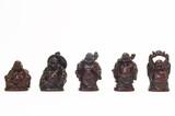 buddha toys on white poster