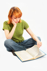 young girl read the book on white