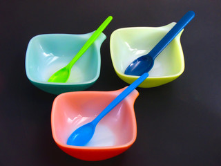 coloured bowls with spoons