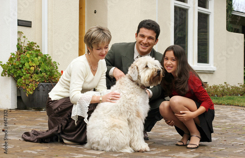 poster of happy family with a dog