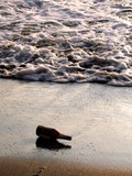 glass bottle washed up on the shore poster