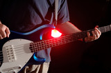 guitar performance - bass with backlight - music band poster