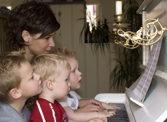 family playing piano