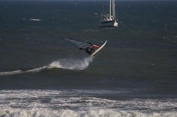 sailboarder rides  waves at punta san carlos