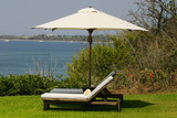shade umbrella with two lounge chairs poster
