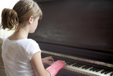 girl with broken arm plays piano poster