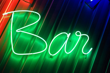 green neon sign bar