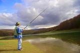 fisherman catching fish poster