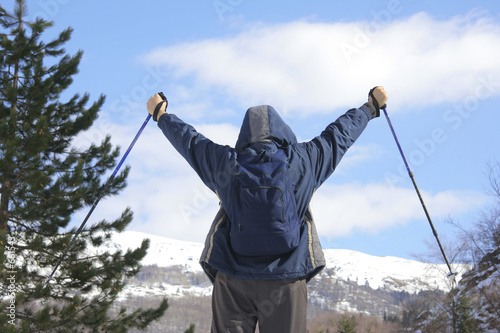 poster of climber standing on top of a mountain