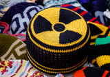 nuclear radiation hazard sign on knitted hat poster