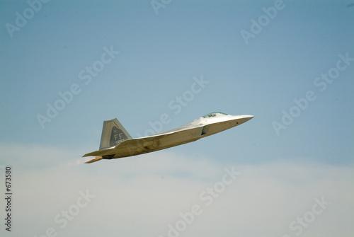 poster of f22 raptor fighter on full afterburner