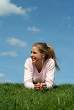 girl lying on the grass poster