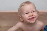 joyful baby in bath poster