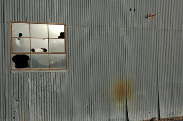 broken window on abandoned warehouse
