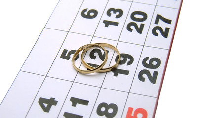 wedding rings on a calendar
