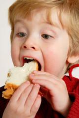 enjoying a peanut butter and jelly sandwich