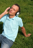 young man enjoying music poster