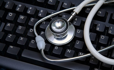 stethoscope on a computer keyboard
