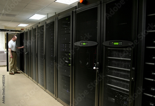 technician working on racks of 1u and 2u servers