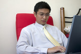 young asian entrepreneur working with computer poster