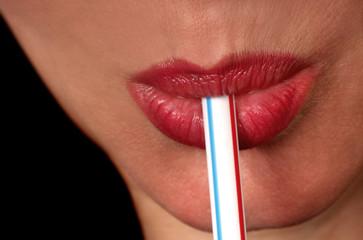 woman sucking straw