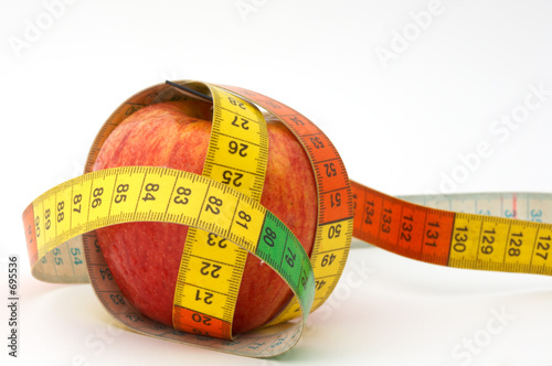 red apple with tape to measure