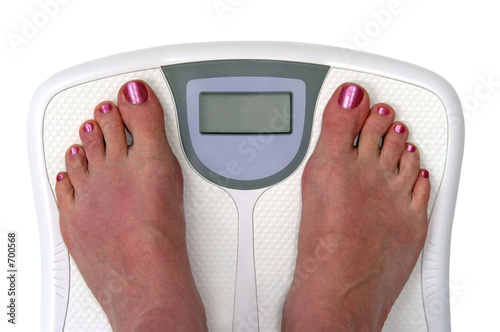 feet on a bathroom scale - isolated