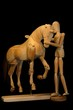 wooden horse with mannequin