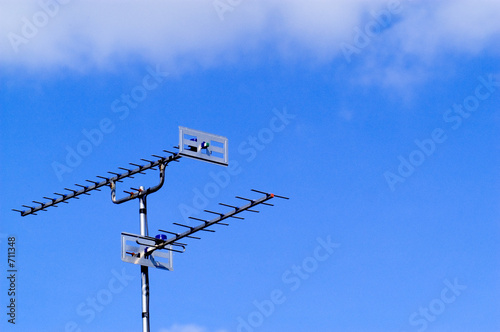 television arials in blue sky
