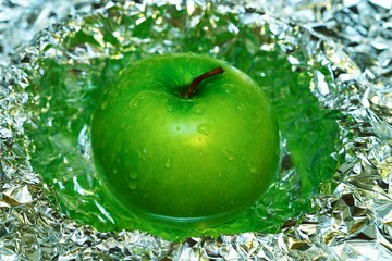 green apple in foil and water