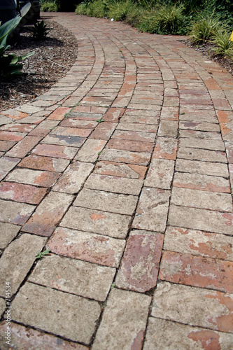 curved red-brick pathway