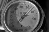 old time thermometer b/w poster
