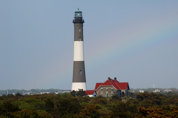 lighthouse with rainbow