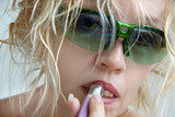woman in green sunglasses poster