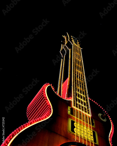Leinwanddruck Bild guitar and neon