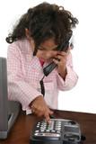 little girl dialing phone at desk poster