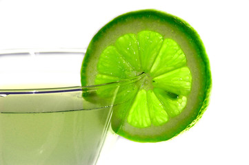 glass and green lemon on a white background