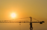 construction crane at sunset poster