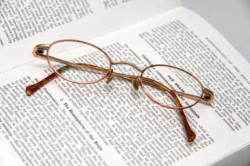 pair of glasses on a medical book