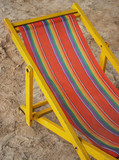 bright old deck chair poster